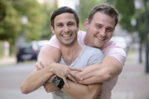 Portrait of a happy gay couple outdoors; Blog: Fertility Options for Same-Sex Couples
